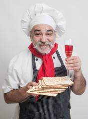 smiling chef with matzot and wine