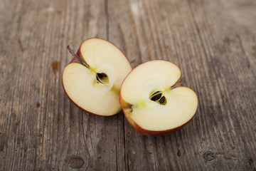 Slices apples on wooden surface
