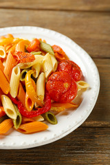 Pasta salad with pepper, carrot and tomatoes