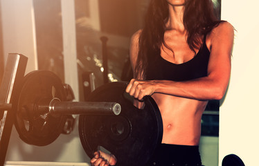Fitness wonam with dumbbells. Close-up shot of torso