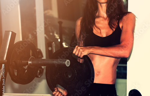 Tuinposter Gymnastiek Fitness wonam with dumbbells. Close-up shot of torso