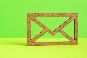 Wooden envelope icon on green background