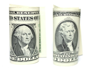Close up of one and two dollars isolate on white background.
