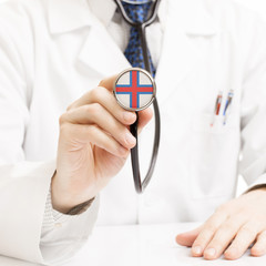 Doctor holding stethoscope with flag series - Faroe Islands