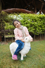 Girl riding sheep#2