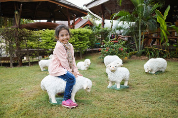 Girl riding sheep#1