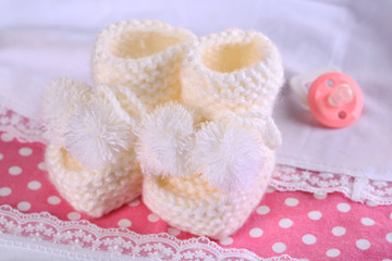 White baby boots on cloth close-up