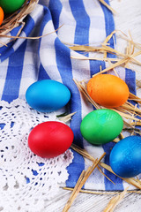 Easter eggs on color wooden background