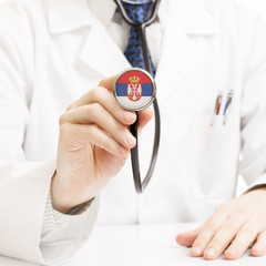 Doctor holding stethoscope with flag series - Serbia