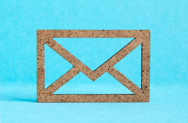 Wooden envelope icon on blue background