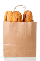 Bread in paper bag on white background