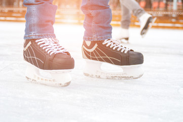 Man feet on skating rink