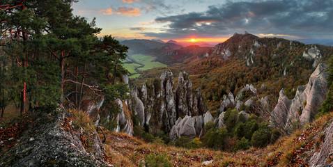 Autumn mountain at sunset with rocks
