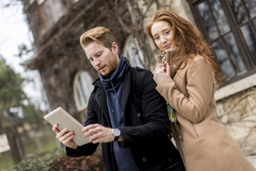 Couple taking photo with tablet