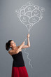 Happy woman holding smiling balloons drawing