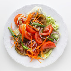 Salad with carrots, tomatoes and onions