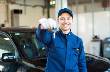 Mechanic giving you the car keys