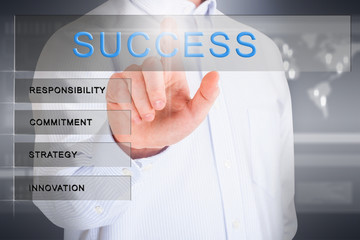 Man pointing success word in a tech screen