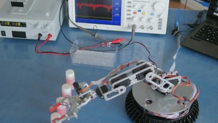 Experimental robot adds vials in a box