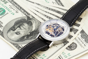 clock and money close-up. Time is money concept
