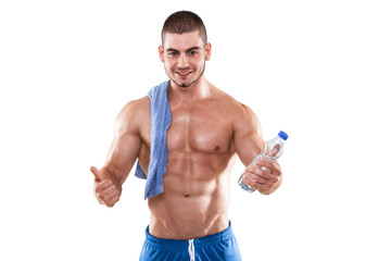 Muscular Man With A Towel And Water