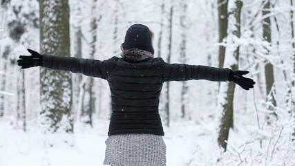 Young women enjoying winter day outdoors, slow motion