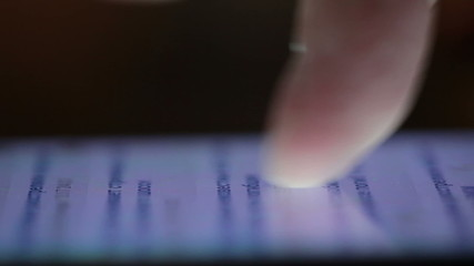 Close-up of finger touching smartphone touchscreen