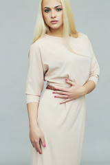 fashionable beautiful young woman in dress.Fashion blond girl