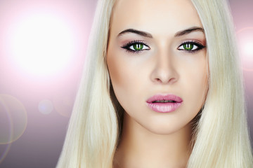 Young Beautiful blond woman.Beauty Girl.make-up.flashlights