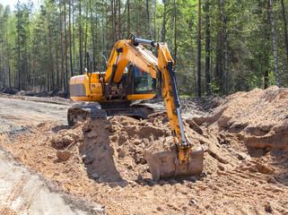 Excavator working on road construction