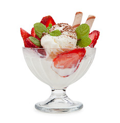 Delicious ice cream with strawberries in a glass vase on a white