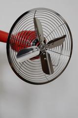 vintage metal fan on neutral background