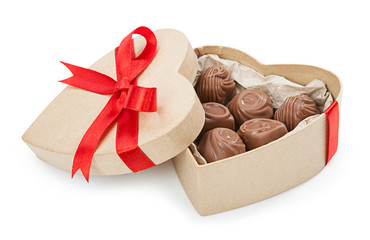 Chocolate candy in a box with a red bow