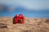 Terracotta color gift box ona beach