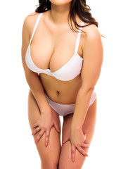 Sexy woman in an underwear, white background, isolated