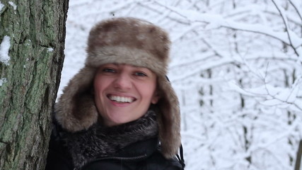 Portrait of a young woman in winter forest