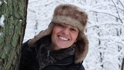 Portrait of a young woman in winter forest, slow motion