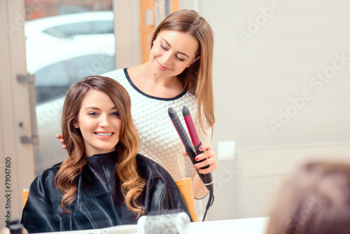 Beautiful woman in hair salon - 79047600