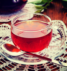 Tea in a glass cup. Vintage retro hipster style version