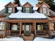 Leinwanddruck Bild - front of a winter cottage