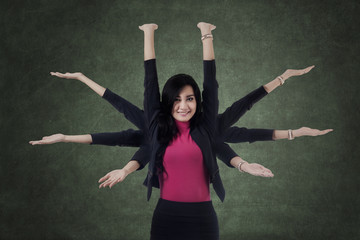 Female manager with eight hands