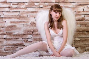Angel girl with brick background