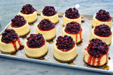Cheesecake with red berries in the bakery