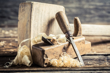 Wooden hammer and planer in a carpentry workbench