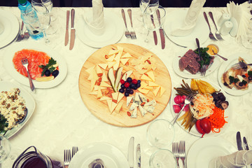 Festive table of salads and appetizers, top view