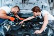 Car mechanics at the service station - 79050688