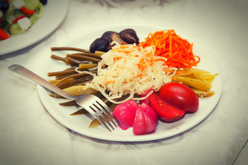Dish with marinated pickles - garlic, tomato, cabbage, pepper,