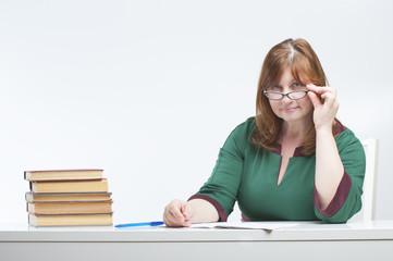 Woman teacher checks the notebook..