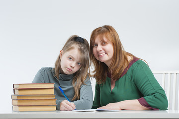 Woman with child doing homework..