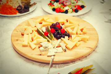 Cheese plate in a restaurant decorated with fruit